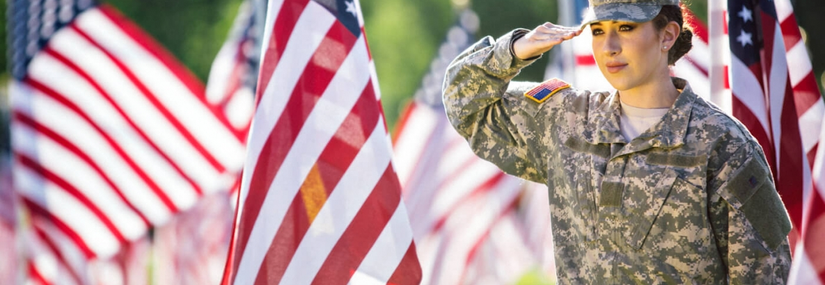 military person saluting the flag
