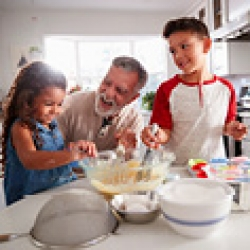 picture of a grandfather with grandkids baking something