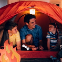 picture of a dad inside a tent with his kids