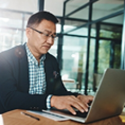 Picture of a man working at his computer
