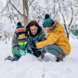 picture of a family playing in the snow