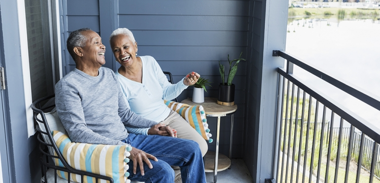 picture of a couple laughing on the porch
