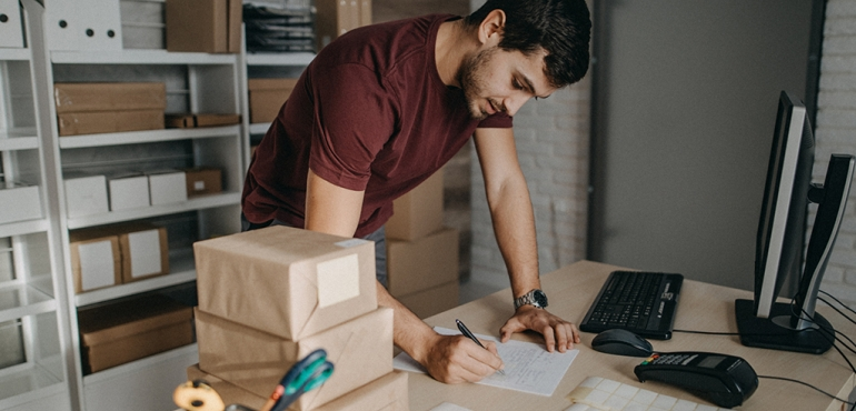 picture of a man writing something down